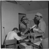 Veterans filling out paperwork to purchase Quonset huts and other surplus military supplies, Port Hueneme, July 15, 1946