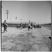 Veterans arrive at Port Hueneme for a Quonset hut and surplus military supply sale, Port Hueneme, July 15, 1946