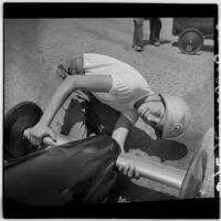 Al Pedrosa looks up from checking on his soap box derby car, Los Angeles, 1946