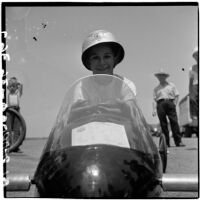 Al Pedrosa smiling in his soap box derby car, Los Angeles, 1946
