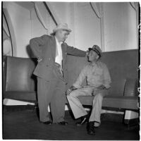 Tony Cornero with Capt. Robert C. Burdett, the skipper of his newly refurbished gambling ship, the Bunker Hill or Lux, Los Angeles, 1946