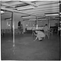 Tony Cornero feeling the floor on his newly refurbished gambling ship, the Bunker Hill or Lux, Los Angeles, 1946