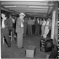 Tony Cornero surrounded by staff on his newly refurbished gambling ship, the Bunker Hill or Lux, Los Angeles, 1946