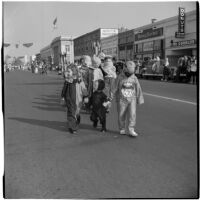 Children in costumes marching in the Labor Day parade, Los Angeles, 1946