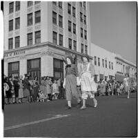 Pair dressed as Raggedy-Ann and Andy marching in the post-war Labor Day parade, Los Angeles, 1946