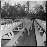 Costumed men setting up picnic tables for the post-war Labor Day celebration, Los Angeles, 1946