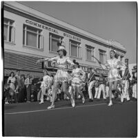 Marching band led by baton twirlers participating in the post-war Labor Day parade, Los Angeles, 1946