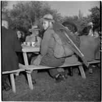 W.J. Stowe sitting at a picnic table during Anaheim's annual Halloween festival, Anaheim, October 31, 1946
