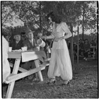 Claudia Martinez pours a cup of coffee for Ed Hackley during Anaheim's annual Halloween festival, Anaheim, October 31, 1946