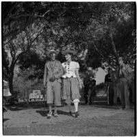 Buck Reisinger and Alice Wisser walking arm-in-arm during Anaheim's annual Halloween festival, Anaheim, October 31, 1946