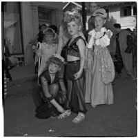 Sally and Sue Newland with other children in costume for Anaheim's annual Halloween festival, Anaheim, October 31, 1946