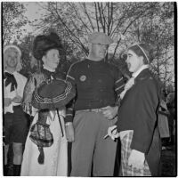 Anaheim mayor Charles A. Pearson and his wife Sarah Fay Pearson talking to a clown at Anaheim's annual Halloween festival, Anaheim, October 31, 1946
