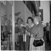 Mrs. Monte Webb and Mrs. W. R. Reinhart window shopping during Anaheim's annual Halloween festival, Anaheim, October 31, 1946