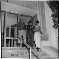 Elks Club manager Len P. Bonnat and two others during Anaheim's annual Halloween festival, Anaheim, October 31, 1946