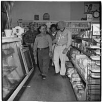 A. Anton and others in a convenience store during Anaheim's annual Halloween festival, Anaheim, October 31, 1946