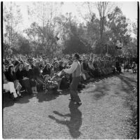 Juggler Val Setz entertains the crowd at Anaheim's annual Halloween festival, Anaheim, October 31, 1946