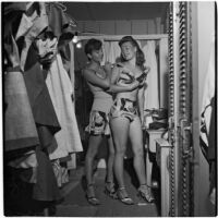 Swim suit models in their dressing room before a fashion show featuring local designers, Los Angeles, September 1946