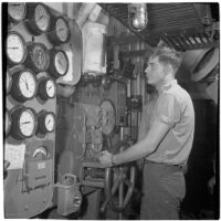 Man operates a machine during the Army-Navy maneuvers off the coast of Southern California in late 1946