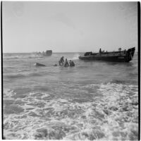 Military personnel practice a water rescue during the Army-Navy maneuvers that took place off the coast of Southern California in late 1946