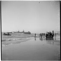 Military personnel on the beach during the Army-Navy maneuvers that took place off the coast of Southern California in late 1946