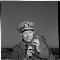 Military commander on his radio during the Army-Navy maneuvers that took place off the coast of Southern California in late 1946