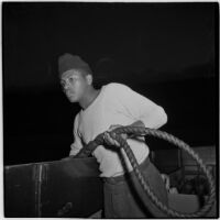 Sailor holding a rope during the Army-Navy maneuvers off the coast of Southern California in late 1946