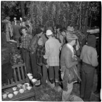 Boy Scout Troop 47 drinking hot chocolate after being marooned overnight in the Arroyo Seco Canyon, Los Angeles, December 9, 1946