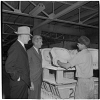 R. E. Davis and factory manager W. Fulton inspecting a completed ceramic sink at the Universal Vitreous China Factory, Mentone, circa 1948