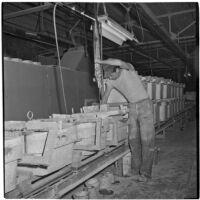 Employee working at the Universal Vitreous China Factory, Mentone, circa 1948