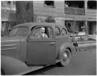 Unidentified photograph of man in car
