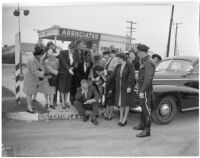 Chamber of Commerce ladies chastising Dick Russell for speeding ticket, Los Angeles, 1947