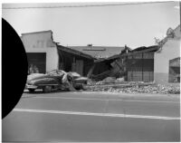 Wreckage after an automobile swerved off the road and crashed into the front of a building, Los Angeles, 1940s