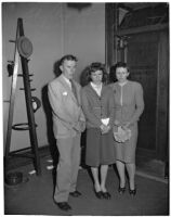 Shirley Smith stands with her mother, Betty Alice Phillips, and father, Melvin David Smith, outside of the courtroom while Superior Judge Fred Miller decides on a home for her after her divorced parents declare they do not want custody, Los Angeles, 1947