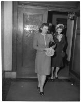 Betty Alice Phillips walks out of Superior Court with her mother, Alice Campbell, after declaring she wanted to relinquish custody of her two children, Los Angeles, 1947