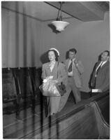 Melvin David Smith walks into Superior Court with his sister-in-law after declaring he wanted to relinquish custody of his two children, Los Angeles, 1947