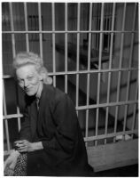 Louise Henderson Carringer sits in jail after police officers find her seven-year-old daughter, Linda Carringer, asleep alone in a car, Los Angeles, 1947