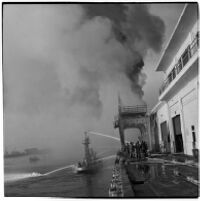 Coast guard and fire fighters working to extinguish the fires that began when the Markay oil tanker exploded in L.A. Harbor, Los Angeles, 1947