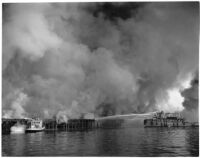 U.S. Navy Tugboat 539 fighting fires that erupted from the Markay oil tanker explosion in L.A. Harbor, Los Angeles, 1947