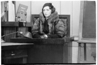 Actress Bebe Daniels on the witness stand during a trial for Albert F. Holland, who wrote 150 love letters to Daniels, Los Angeles, 1933
