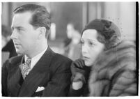Actor Ben Lyon with his wife, actress Bebe Daniels, during a trial for Albert F. Holland, who wrote 150 love letters to Daniels, Los Angeles, 1933