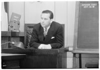 Actor Ben Lyon on the witness stand during a trial for Albert F. Holland, who wrote 150 love letters to Lyon's wife, actress Bebe Daniels, Los Angeles, 1933