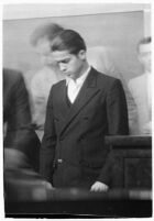 Louis Rude Payne at an inquest for the murder of his mother and younger brother, Los Angeles, June 6, 1934