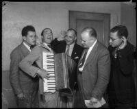 Don Dixon demonstrating his accordion skills to Judge William R. McKay, Los Angeles, 1934