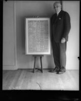 California Governor Frank Finley Merriam next to a copy of the United States Constitution, Los Angeles, 1930s