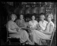 Newly elected president of the Los Feliz Women's Club Mrs. Katherine G. Cornell seated at a table with other club members, Los Angeles, 1935