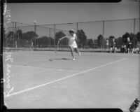 Louise Martin plays tennis, Los Angeles, 1930s
