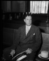 Kent Parrot, politician and attorney, sits in a courtroom, Los Angeles, 1930s