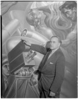 """Artist Leo Katz points the """"Youth Arisen"""" panel of his mural at the Frank Wiggins Trade School, Los Angeles, 1935"""
