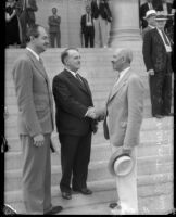 Mayor Shaw, A.F. Southwick, and David A. Smith stand together on the steps of city hall, Los Angeles, 1930s