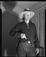 Dr. Ralph Wagner poses with a gun and hat, Los Angeles, 1930s